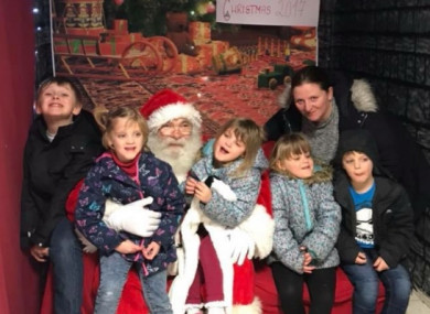 Mary Gore and her children meeting Santa this year.