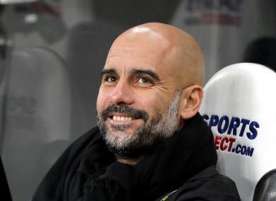 No wonder he's happy: Pep's City are 15 points clear at the top of the league.