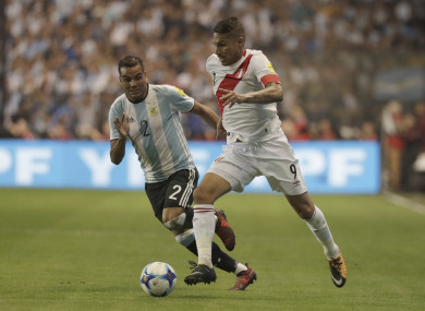 Paolo Guerrero in possession for Peru against Argentina.