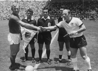 Bobby Moore alongside Germany captain Uwe Seeler.