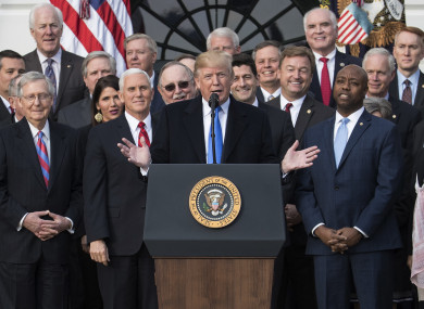 US President Donald Trump joined by members of congress speaking during an event on the South Lawn of the White House in Washington.