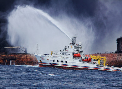 Rescuers spray foam to extinguish flames on the stricken oil tanker SANCHI off the coast of east China's Shanghai.