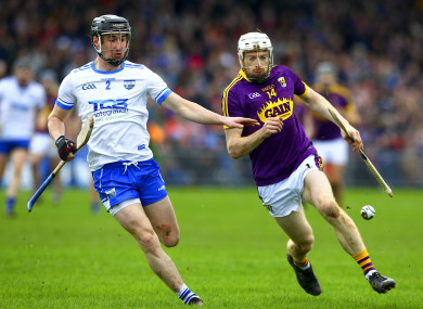 Dunne in action against Conor Gleeson of Waterford.