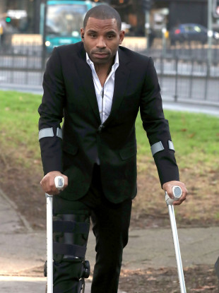 Puncheon arriving in court on crutches today.