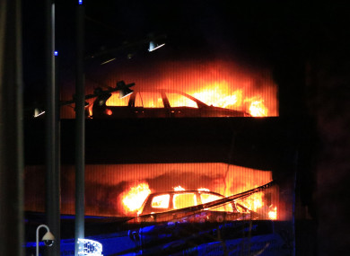The fire tearing through the multi-storey car park at the Echo Arena in Liverpool last night.