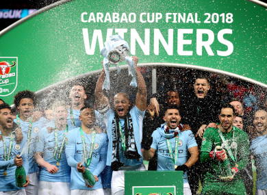 Kompany lifts the Carabao Cup trophy.