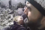 The infant was rescued from rubble in Douma city.