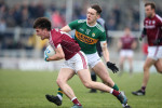 Kerry's David Clifford tackles Galway's Sean Kelly.