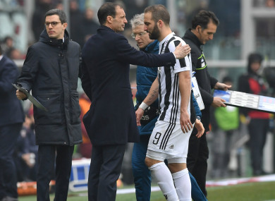 Higuain trudges off the pitch.