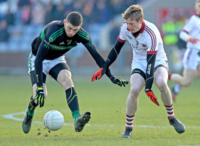Luke Connolly and Brendan Rogers battling for possession.