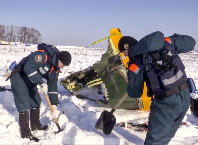 An emergency team works at the scene of the plane crash