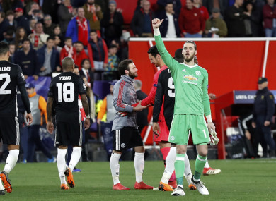 Manchester United goalkeeper David de Gea, right, gestures to the supporters at the end.