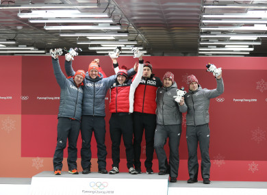 Gold medalists Germany's Johannes Lochner and Christopher Weber, Canada's Justin Kripps and Alexander Kopacz, bronze medalists Latvia's Oskars Melbardis and Janis Strenga (L to R) pose for photos.