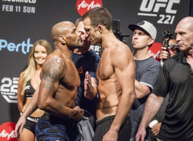 Yoel Romero and Luke Rockhold during the UFC 221 weigh ins at Perth Arena.