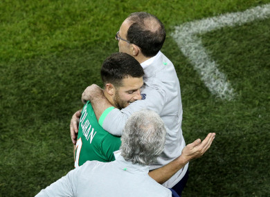 O'Neill and Hoolahan share a hug.
