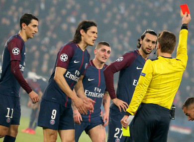 Marco Verratti of PSG receives a red card and is sent off by referee Felix Brych of Germany while Angel Di Maria, Edinson Cavani and Javier Pastore protest.