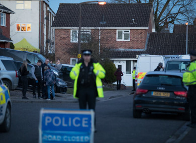 Police officers search the home of Sergei Skripal.