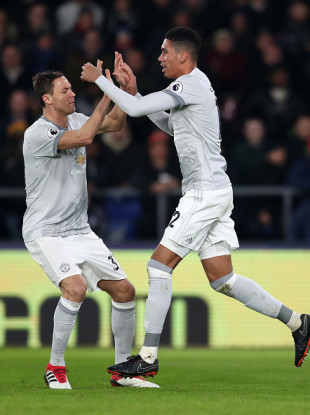 Nemanja Matic and Chris Smalling celebrate.