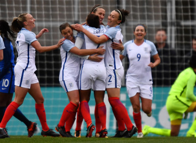 Jill Scott #8 of England celebrates her first half goal against France with teammates.