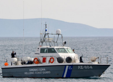 A coast guard vessel arrives at the port of Pythagorio with the bodies of people who died today