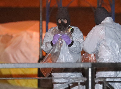 Police officers in forensics suits and protective masks work at the scene of the poisoning of Sergei Skripal.