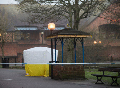 A forensic tent stands over a bench in Salisbury where the man and woman were found unconscious