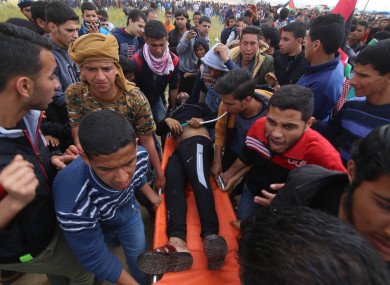 A wounded Palestinian is evacuated during clashes with Israeli troops near the Gaza-Israel border.