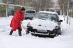 Photographer Leon Farrell digs his car out of the snow in Athgarvan, Co Kildare, yesterday.
