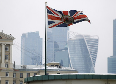 The Union Jack flag waving by the British Embassy with the towers of the Moscow International Business Centre in the background.