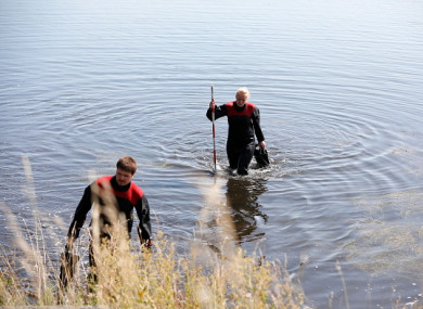 Members of the Danish Emergency Management Agency assist police in the search for missing body parts last August