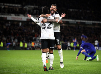 Derby County's Cameron Jerome (left) celebrates scoring his side's third goal with Bradley Johnson.