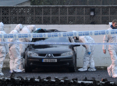 Gardai examine a car in the wake of the shooting at the Huntsman Inn in 2013.