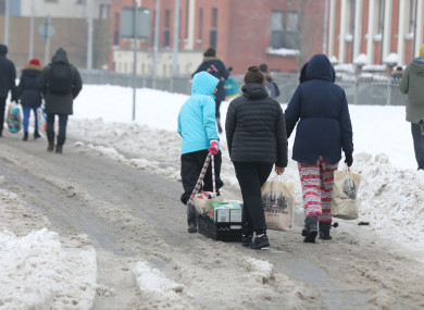People walking in the snow during Storm Emma in March.