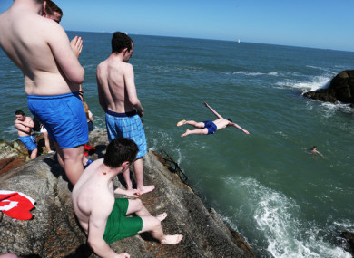 File image: Swimmers enjoy the sun at the Forty Foot.