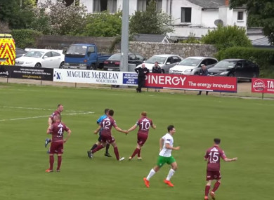 Galway United players confront the referee after the goal.