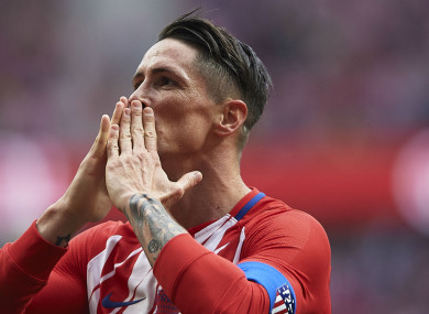 Fernando Torres blows kisses to the Atleti crowd.