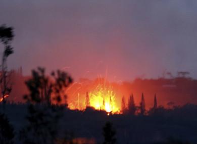 Lava shoots into the night sky from active fissures on the lower east rift of the Kilauea volcano, near Pahoa, Hawaii.