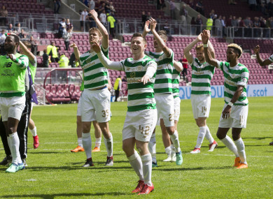 Callum McGregor (centre) celebrates with team-mates after the Ladbrokes Scottish Premiership match at Tynecastle.