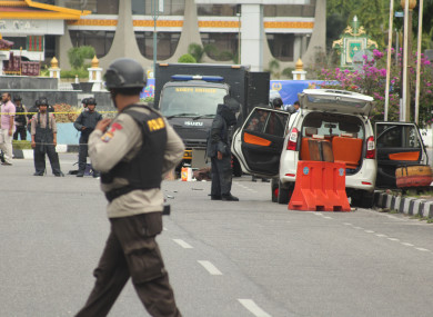 Police searching the attackers' vehicle for bombs.