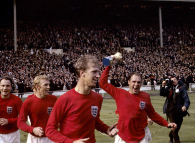Wilson lifting the World Cup trophy with team-mates George Cohen, Bobby Moore and Jack Charlton.