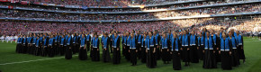 A choir performs on the pitch before the 2014 Champions League final.