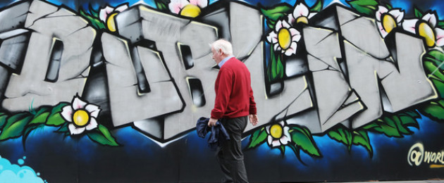 A member of the public passing by graffiti in Dublin city centre today