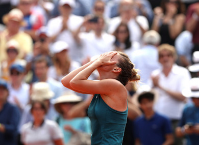 Halep celebrates victory at Roland Garros.