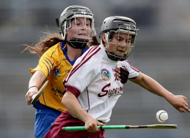 Aoife Donohue and Ciara Doyle battle for possession.