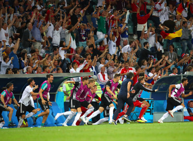 The Germany bench celebrates after Toni Kroos scored a late winner against Sweden.