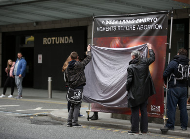 Banners belonging to the Irish Centre for Bio-Ethical Reform (ICBR) being blocked by pro-choice activists outside the Rotunda Hospital in Dublin.