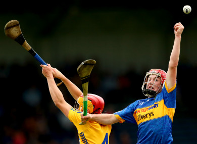 Clare's Mike Gough and Devon Ryan of Tipperary.