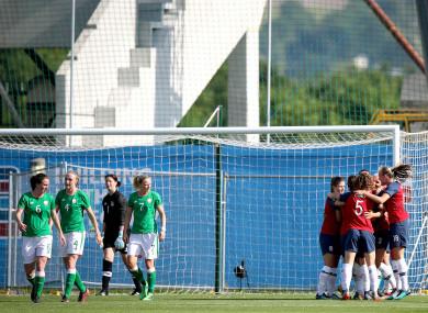 The Norwegian celebrate their first goal.