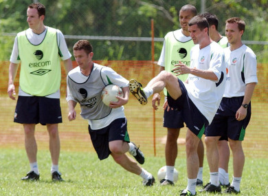 Roy Keane joins in team exercises Wednesday 22nd May 2002 in Saipan.
