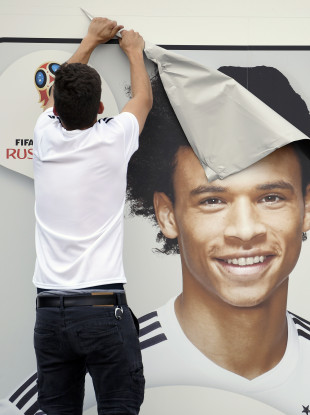 A picture of Sane is taken off a wall of the German soccer museum in Dortmund.